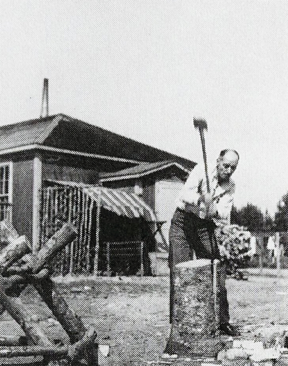 Arcand splits a log in Fredericton concentration camp at New Brunswick.
