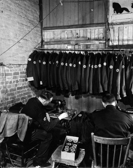Assembly of party uniforms, 1940./ <i>Assemblage des uniformes du parti</i>, 1940.
