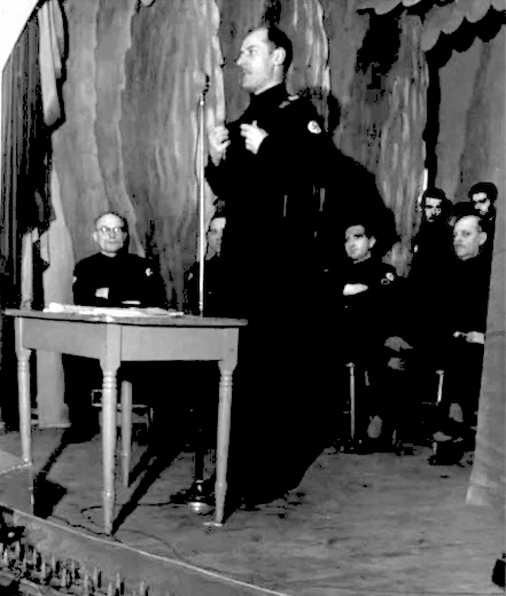 Young Christian leader Adrien Arcand lecturing on stage (date unknown)